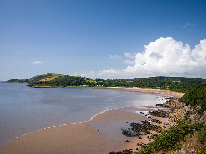 Golden sands of Sandyhills Bay beach